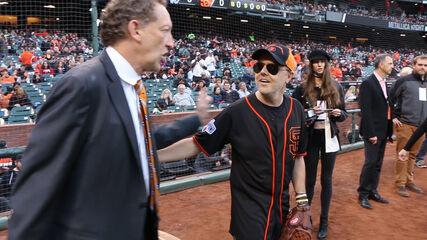Lars Throwing the First Pitch During Metallica Night